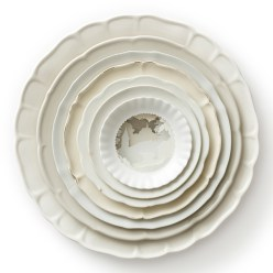 "Caroline Slotte, ""Landscape Multiple (white)"" 2009, reworked second-hand ceramics, 2.5 x 13 x 13""."