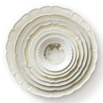 "Caroline Slotte, ""Landscape Multiple (white)"" 2009, reworked second-hand ceramics, 2.5 x 13 x 13""."