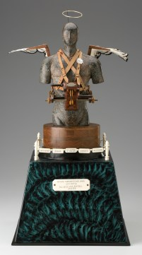 "Roy Superior, ""Patent Model for a Good LIfe"" 1995, soaps stone, wood, polychrome, leather, silver, brass, bone, 20 x 10.25"". (Collection of the Artist)"