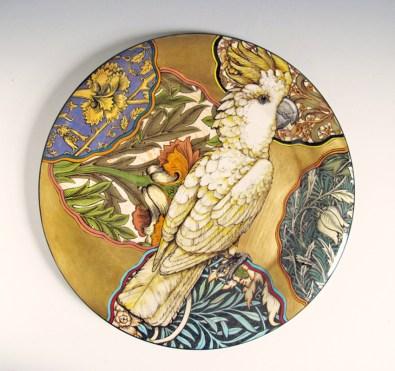 "Stephen Bowers, ""Cockatiel Nymphicus hollandicus"" camouflage plate, 2014, earthenware, underglaze, clear glaze, on-glaze gold lustre, enamel, 12.2""."