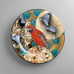 "Stephen Bowers, ""Crimson Rosella"" camouflage plate, 2014, earthenware, underglaze colour, clear glaze, on-glaze burnished gold lustre, 12.2""."