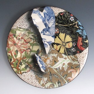 "Stephen Bowers, ""Camouflage Plate"" 2016, earthenware, under glaze colour, clear earthenware glaze, on-glaze burnished gold lustre, enamel, 12.25 x 1""."