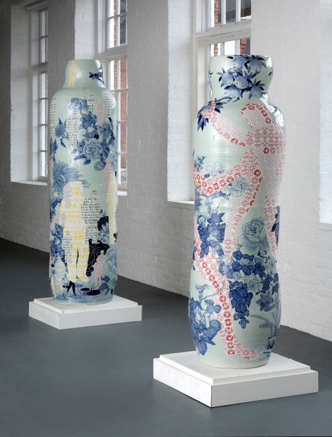 """Sin-ying Ho, left: """"One World, Many Peoples No. 2"""" (77 x 23.25"""") and right: """"Temptation - Life of Goods No. 2"""" (68 x 23.5"""") 2010, porcelain, cobalt pigment, underglaze, decal, glaze."""