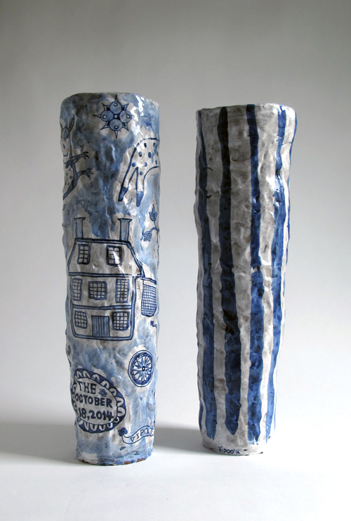 "Vipoo Srivilasa, ""Gun Powder Vase"" (left), ""Indigo Strip"" 2014, ceramic, cobalt, 5 x 5 x 17""."