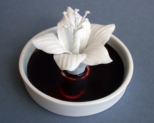 "Julie Bartholomew, ""Rarely Seen, Phillip Island Hibiscus"" 2013, porcelain, copper red glaze, decals, 2.75 x 3.5""."