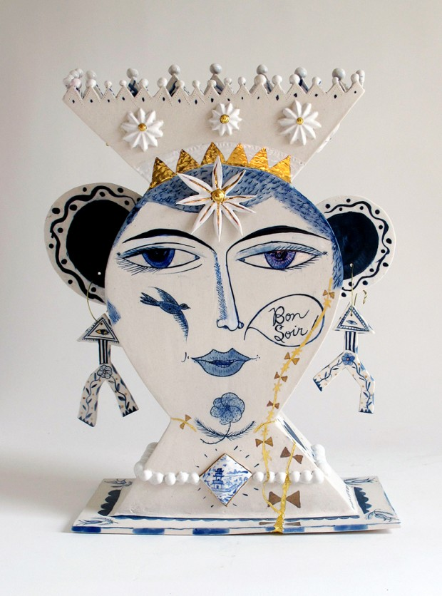 """Mara Superior, """"Wounded Beauty"""" 2014, porcelain, cobalt, glaze, gold luster, metal wire, 12 x 15 x 5.5""""."""