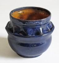 "George Ohr, ""Folded Vessel"" 1897–1900, vivid indigo glaze, stamped G.F. OHR, Biloxi, Miss, 4 x 4.5 x 4.5""."