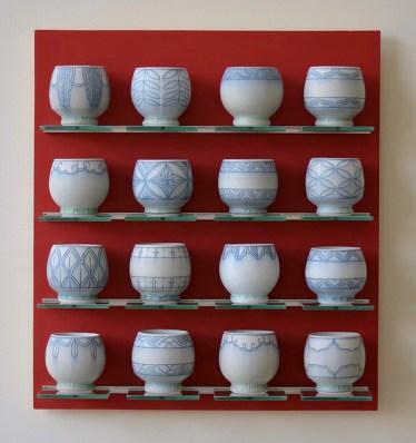 "Steven Young Lee, ""4x4 Cups"" 2016, porcelain, cobalt inlay, plywood, paint, aluminum, glass, 22 x 21 x 6""."
