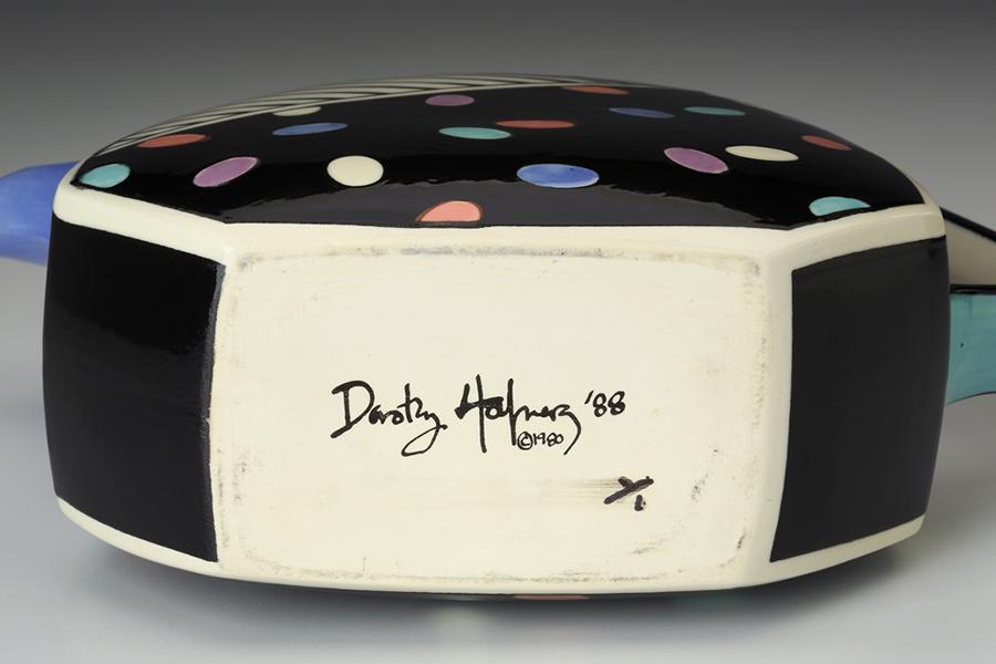 "Dorothy Hafner signature on ""Teapot"" 1988, porcelain, underglaze, 12 x 4 x 10.5""."