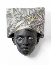 "Cristina Córdova, ""Cabeza VII (Head with Stripes)"" 2019, ceramic, 9 x 7 x 5""."