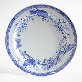 "Paul Scott, ""Scott's Cumbrian Blue(s), New American Scenery, Forget Me Not, Extinct No: 1, Heath Hen, Carolina Parakeet, Passenger Pigeon, Xerces Blues"", 2019, in-glaze screen print (decal) on salvaged Syracuse China with pearlware glaze, 12 x 12 x 1""."