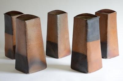 "Mark Pharis, ""Five Vases"" 1995, stoneware, 13.5 x 8 x 6"" each, 38"" wide installed."