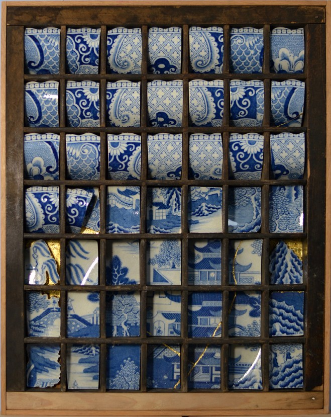 """Paul Scott, """"Scott's Cumbrian Blue(s), Blue Willow in a Tray"""" 2016, collage, cut 19th century Willow pattern transferware bowl, gold leaf, re-purposed print type tray, 14.5 x 10.75""""."""