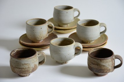 "Warren Mackenzie, ""Set of Six Cups and Saucers"" 2003, stoneware, cup: 3 x 4.5 x 3.5"" saucer: 1 x 6 x 6""."
