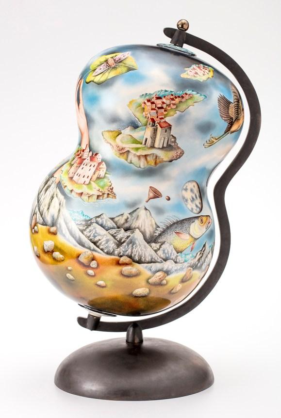 "Kurt Weiser, ""Random House (globe)"" 2017, porcelain, glaze, china paint, metal, 30 x 14 x 14""."