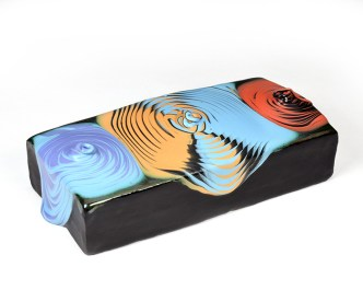 """Mabry, Lauren """"Swirl Brick"""" 2018, earthenware, glaze, 2.5 x 9 x 4""""."""