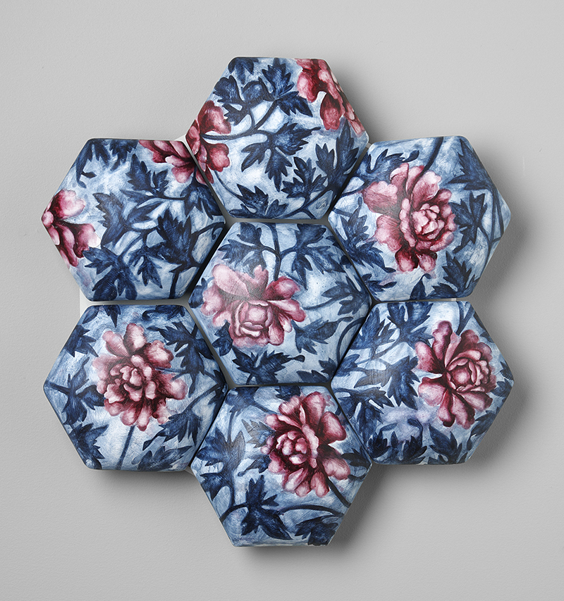 """Giselle Hicks, """"Red and Blue Floral Quilt"""" 2008, ceramic, plaster, watercolors, 16 x16 x 2""""."""