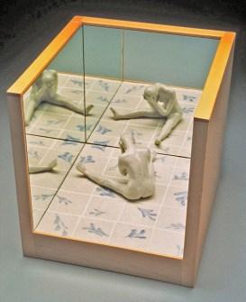 "Coille Hooven, ""Despair"" 1993, porcelain, mirror, wood, figure: 5 x 5.5 x 4"", box: 12 x 12 x 12""."