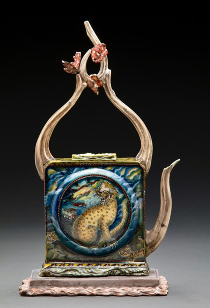 "Susan Thayer, ""Return"" 2016, teapot: porcelain, china paint, glazebase: lowfire stoneware, slip, 16 x 9 x 5""."