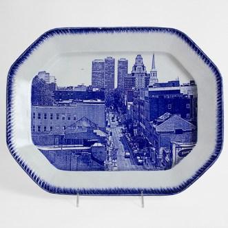 """Cumbrian Blue(s), New American Scenery, Philadelphia"", 2017, in-glaze decal collage on shell-edge, pearlware platter c.1855, 13 x 16.5 x 1.5"", 42 x 33 x 4cm."