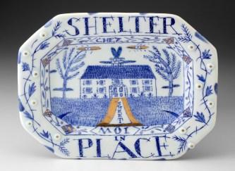 "Mara Superior, ""Shelter in Place"", 2020, English porcelain, cobalt oxide, gold luster, glaze, 7.5 x 9.5 x .75"""