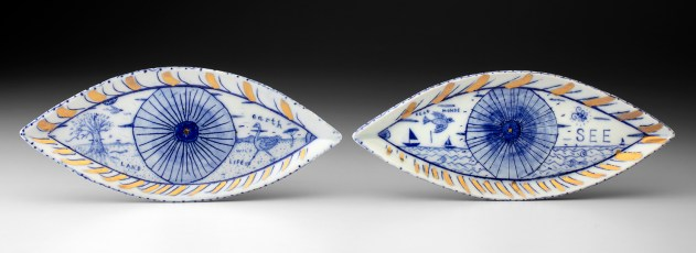 "Mara Superior, ""A Pair of Seeing Eyes"", 2020, English porcelain, ceramic oxides, gold luster, glaze, 4 x 18 x .75"""