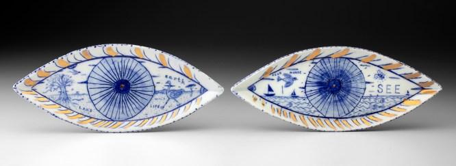 "Mara Superior, ""A Pair of Seeing Eyes"", 2020, English porcelain, ceramic oxides, gold luster, glaze, 4 x 18 x .75"""