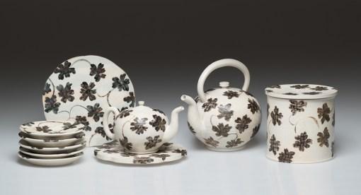 "Linda Sikora, ""Small Group"" 2017–8, porcelain, stoneware, approximate sizes: kettle 10 x 11 x 9"", box 8 x 7 x 7"", stand 1.5 x 11 x 11""."