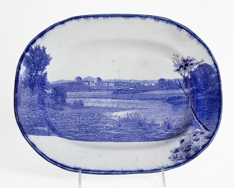 "Paul Scott, ""Scott's Cumbrian Blue(s), American Scenery, Hudson River Indian Point No: 5"" 2017, in-glaze decal, shell-edge, pearlware platter c.1855, 12.75 x 10.5 x 1.5""."