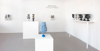 "Peter Pincus: Channeling Wedgwood at Ferrin Contemporary, North Adams, MA, 2018.Peter Pincus: Channeling Wedgwood at Ferrin Contemporary, North Adams, MA, 2018. (Front) 'Relieved', 2018, 17.25 x 9 x 9"", colored porcelain. (back left) 'Wedgwood Krater Pair', 2018, 17.25 x 19 x 7"" (each), (Back Center )'Teapots', 2018, 10.125 x 5 x 5"" (each), colored porcelain. (Right) 'Calyx Krater: Excerpt from One Shows Two, Two Influence Twenty', 2018, 12.75 x 10.5 x 10.5"" (each)."
