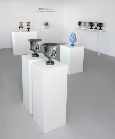 "Peter Pincus: Channeling Wedgwood at Ferrin Contemporary, North Adams, MA, 2018. (Front and Back Right)'Calyx Krater: Excerpt from One Shows Two, Two Influence Twenty', 2018, 12.75 x 10.5 x 10.5"" (each). (Center Right) 'Relieved', 2018, 17.25 x 9 x 9"", colored porcelain. (Back Left) 'Wedgwood Krater Pair', 2018, 17.25 x 19 x 7"" (each), (Back Right)'Teapots', 2018, 10.125 x 5 x 5"" (each), colored porcelain."