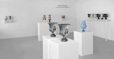 "Peter Pincus: Channeling Wedgwood at Ferrin Contemporary, North Adams, MA, 2018. (front center) 'Calyx Krater: Excerpt from One Shows Two, Two Influence Twenty', 2018, 12.75 x 10.5 x 10.5"" (each). (back left) Wedgwood Krater Pair, 2018, 17.25 x 19 x 7"" (each), (back right )Teapots, 2018, 10.125 x 5 x 5"" (each), colored porcelain. (right) Relieved, 2018, 17.25 x 9 x 9"", colored porcelain."