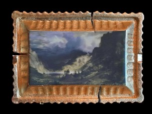 "Evan Hauser, ""Preservation & Use (A Storm in the Rocky Mountains, Mt. Rosalie, Albert Bierstadt, 1866)"" 2019, porcelain, digital ceramic print, gold leaf, 10.5 x 15 x 2.5""."