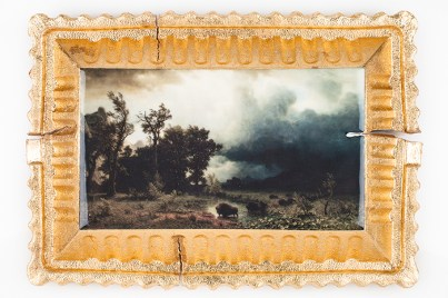 "Evan Hauser, ""Preservation & Use (Buffalo Trail: The Impending Storm, Albert Bierstadt, 1869)"" 2019, porcelain, digital ceramic print, gold leaf, 10.5 x 15 x 2.5""."