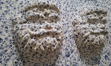"Hollie Lyko, ""Delft Santa"", 2019, slip-cast porcelain, decals, MDF, 44 x 60 x 5""."