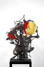 "Raymon Elozua, 2016, photo: ""02 Blur S&S 10-7-6_1799"" 2010, archival inkjet print, 17 x 22""; sculpture: ""H: IMF-02"" 2016, terra cotta, white stoneware, glaze, steel rod, steel plate, 23.5 x 17.5 x 20""."