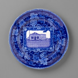 "Paul Scott, ""Scott's Cumbrian Blue(s), New American Scenery, Machita Liquor Store"" 2019, in-glaze screen print (decal) on partially erased transferware plate ""London Views"", c.1830, by Wood, 10 x 10 x 1""."