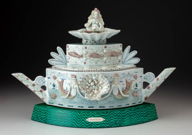 "Mara Superior, ""Fantasia Teapot"", high-fired porcelain, ceramic oxides, underglaze, glaze, faux painting, wood, brass pins, 13.5 x 8.5 x 20""."