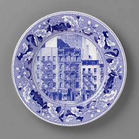 "Paul Scott, ""Scott's Cumbrian Blue(s), New American Scenery, Fleurs.de.sel's New York, Dazzle, Chicken Place, (one of a set of twelve plates)"" 2019, in-glaze screen print (decal) on salvaged Syracuse China with pearlware glaze, 11 x 11 x 1""."