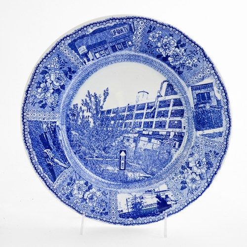 "Paul Scott, ""Scott's Cumbrian Blue(s), New American Scenery, Detroit Ghost Gardens #2"", 2019, in-glaze screen print (decal) on salvaged Syracuse China with pearlware glaze, 12 x 12 x 1.25""."