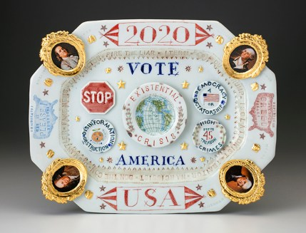 "Mara Superior, ""2020/USA/Vote/America"", 2019, high-fired porcelain, ceramic oxides, underglaze, glaze, ceramic decals, gold leaf, 13 x 16.25 x 2""."