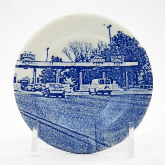 "Paul Scott, ""Scott's Cumbrian Blue(s), New American Scenery, Turnpike/Toll No:3, Cup Plate"", 2019, pearlware with screen-print decal, 4 x 4 x .5"""
