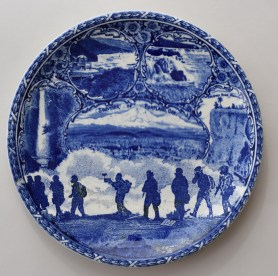 'Cumbrian Blue(s), New American Scenery, Souvenir of Portland Or., Black Lives Matter (After Killen & Howard')/Trumpian Campaigne '. In-glaze screen print (decal) on partially erased, Staffordshire transferware souvenir plate by Rowland & Marsellus, c.1900, 25cm dia. Paul Scott 2020.