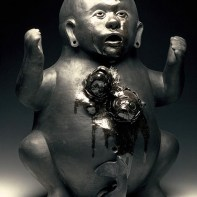 "Kukuli Velarde, ""Fishy Love"", 1997-2006, low-fire black clay, 23 x 15 x 15""."