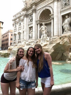 Lilly George with friends in front of Trevi Fountain. Courtesy of Honors student, Lilly George.
