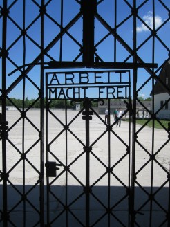 """The gate to Dachau Concentration Camp in Germany. It reads """"Work makes you free."""" Photo by Dan Ruland, used with permission by the Honors Program at Ferris State"""