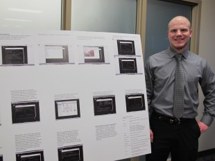 Dalton White with his poster. Courtesy of the photographer.
