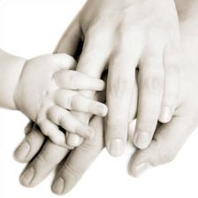 Fertility Clinic - The Fertility Center of Las Vegas - Photo of adult hands with a baby hand on top.