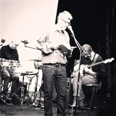 Don Share, editor of Chicago-based Poetry magazine, with musicians at Swindon Festival of Poetry