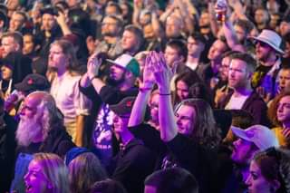 May be an image of 7 people, people standing, people playing musical instruments, crowd and indoor